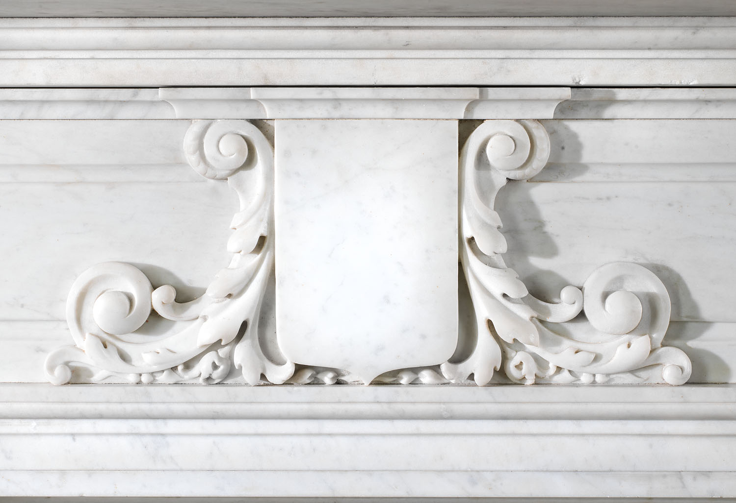 A grand Gothic style antique carrara marble fireplace surround