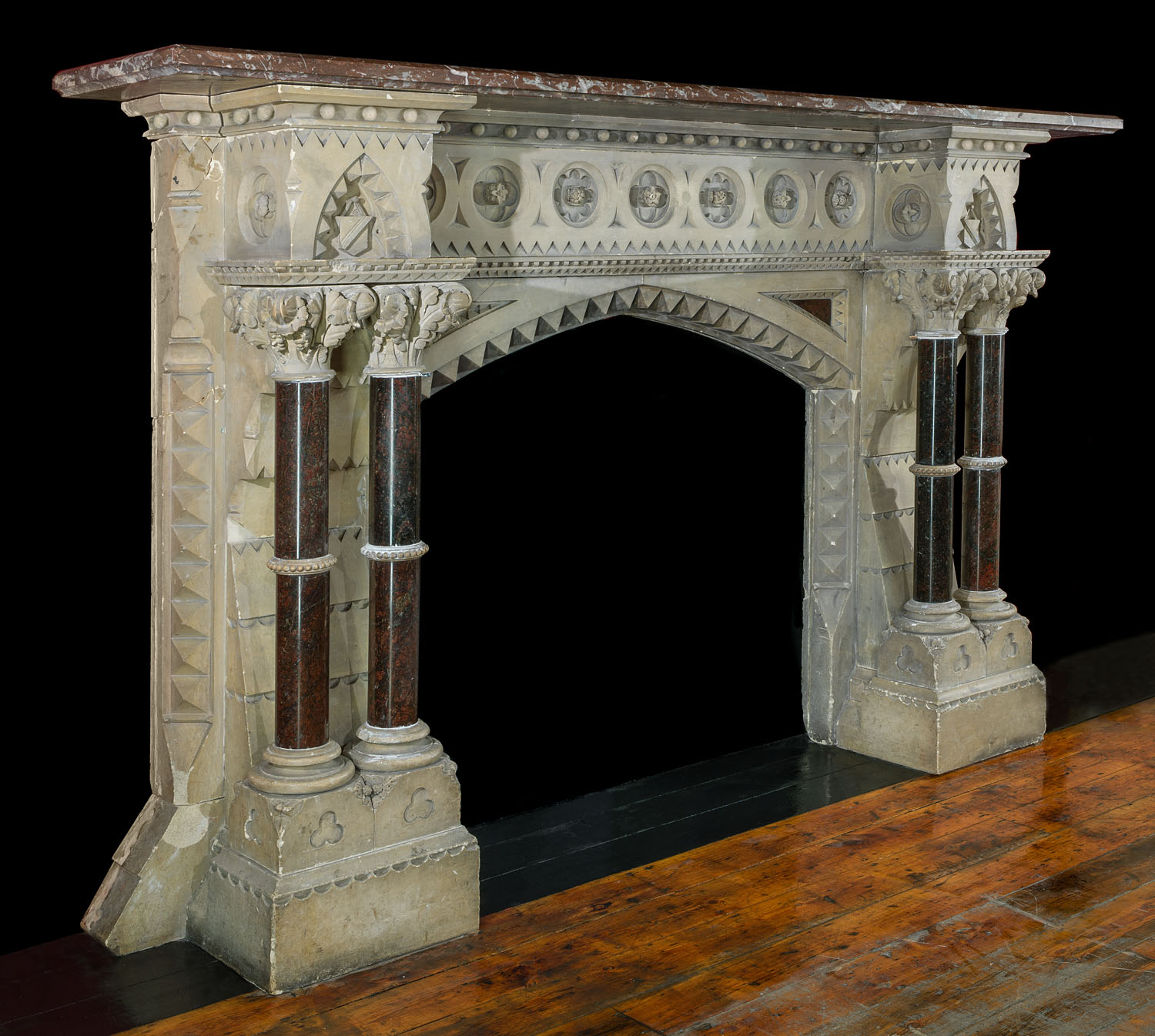 A Victorian Gothic Revival Caen Stone fireplace mantel