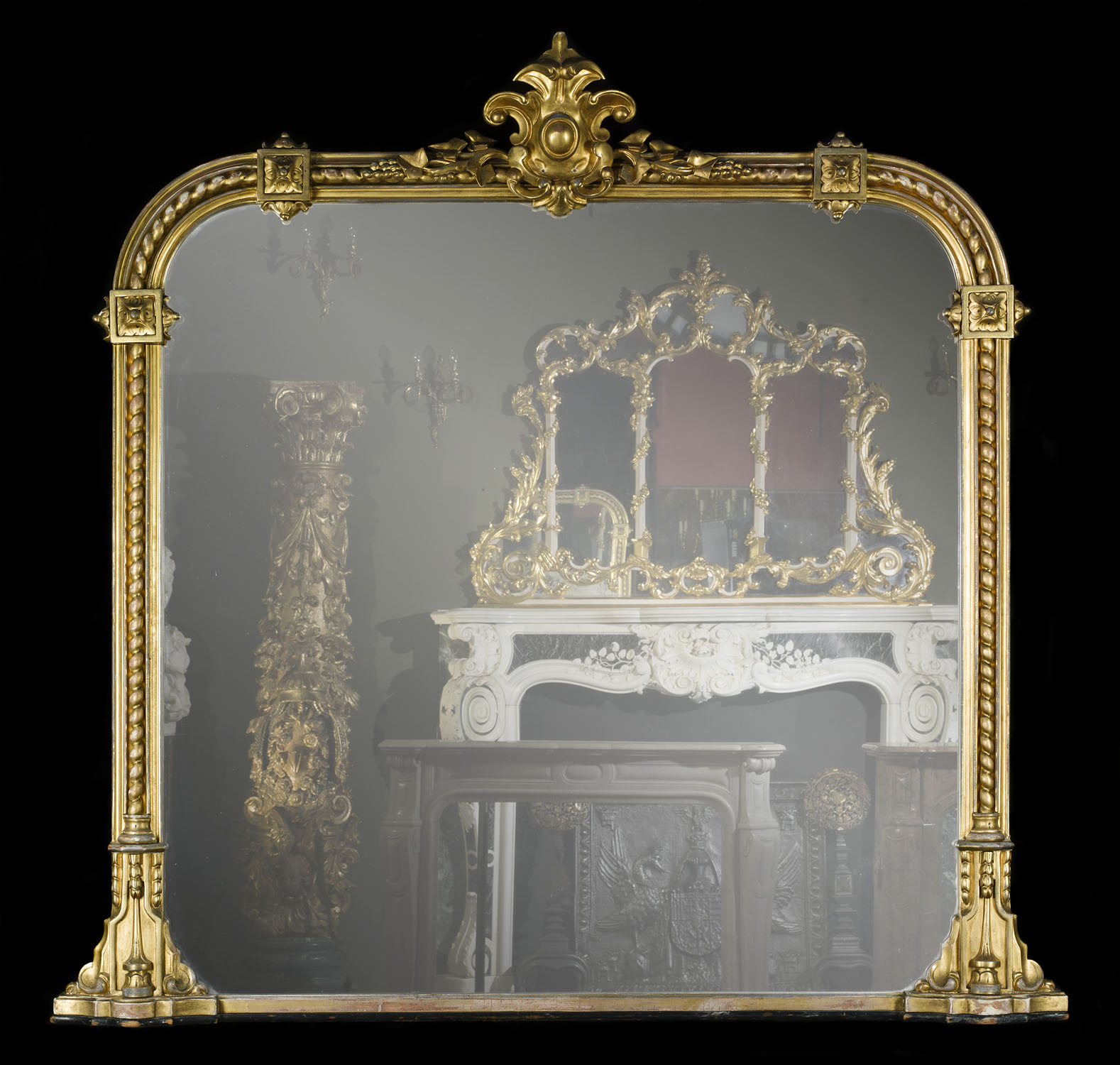 A large Victorian gilt wood antique overmantel mirror