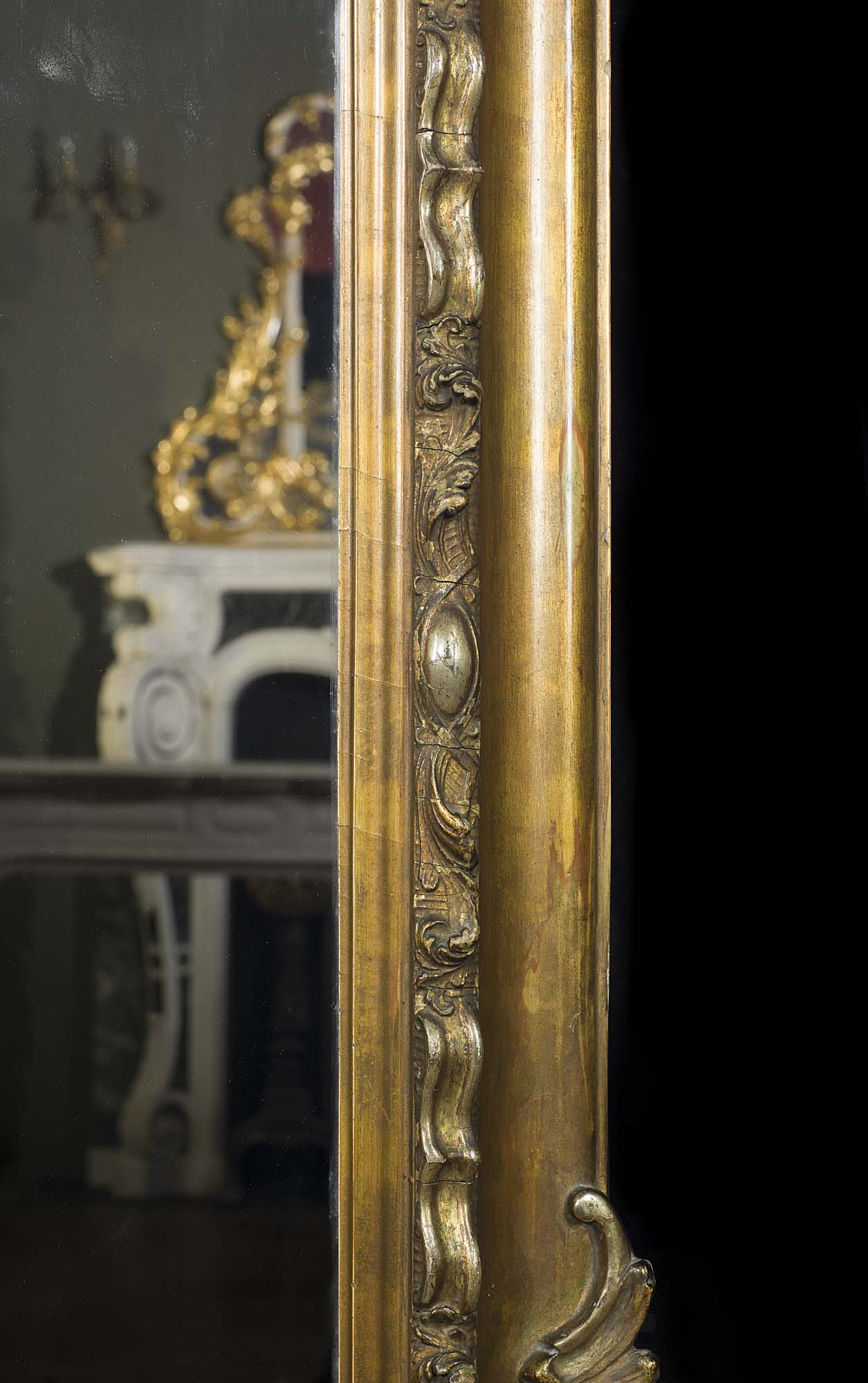 A French antique gilt wood overmantel mirror