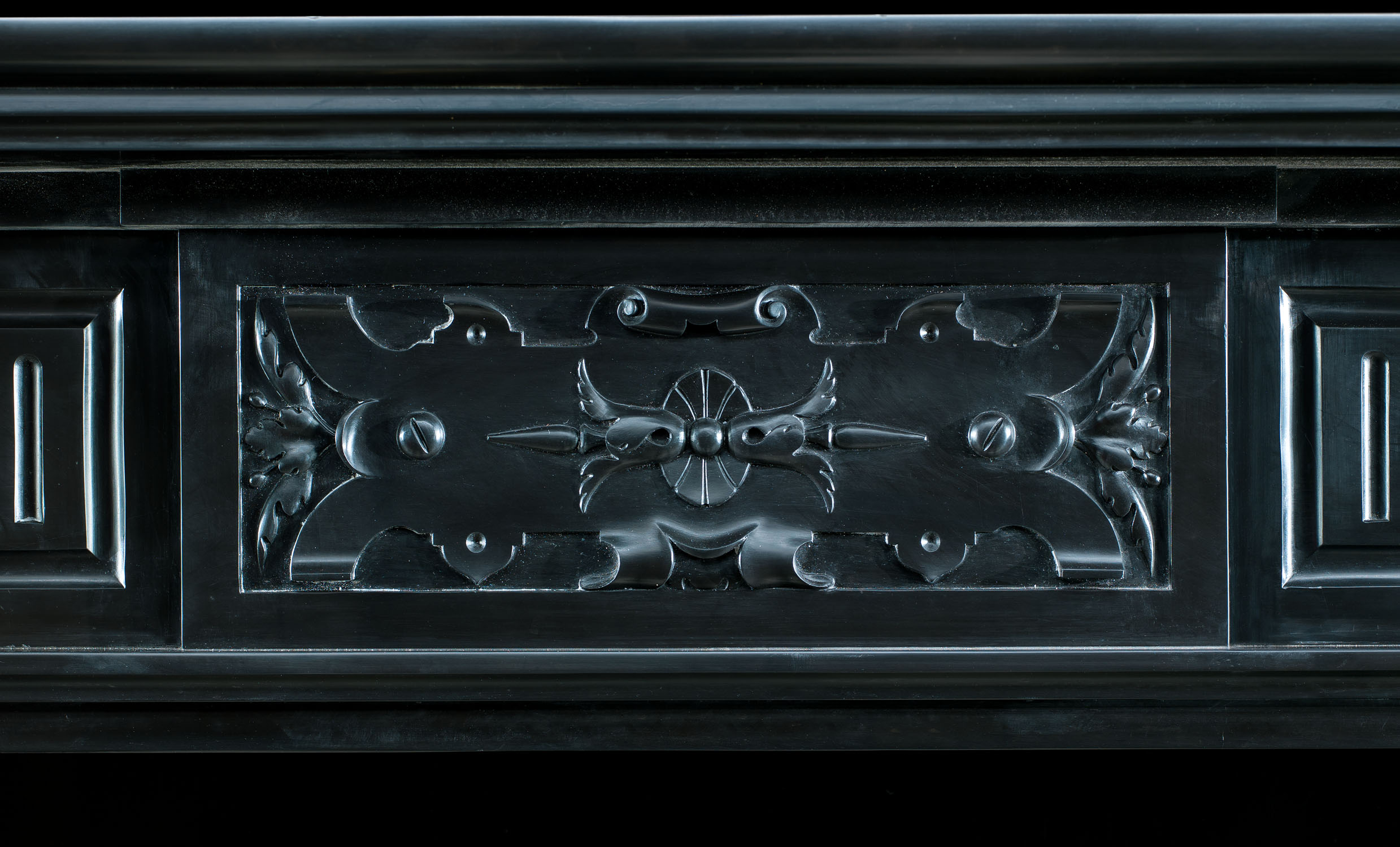 A Belgian Black and Rosso Antico Marble fireplace mantel