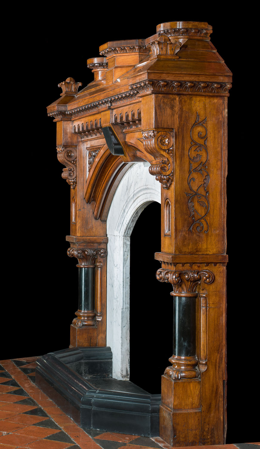 A unique Gothic Revival carved oak fireplace mantel