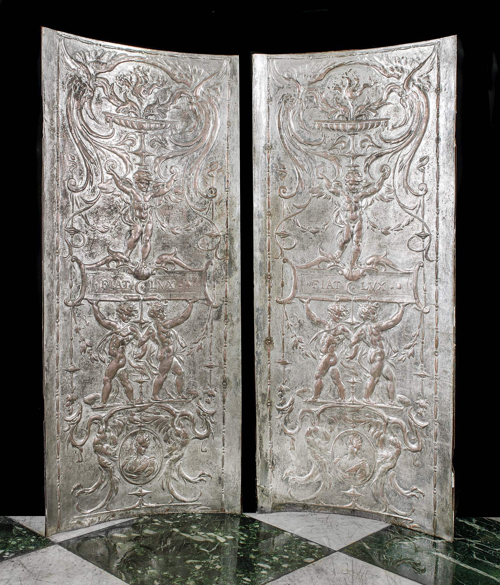 Georgian style pair of silver plated copper fireplace side panels.