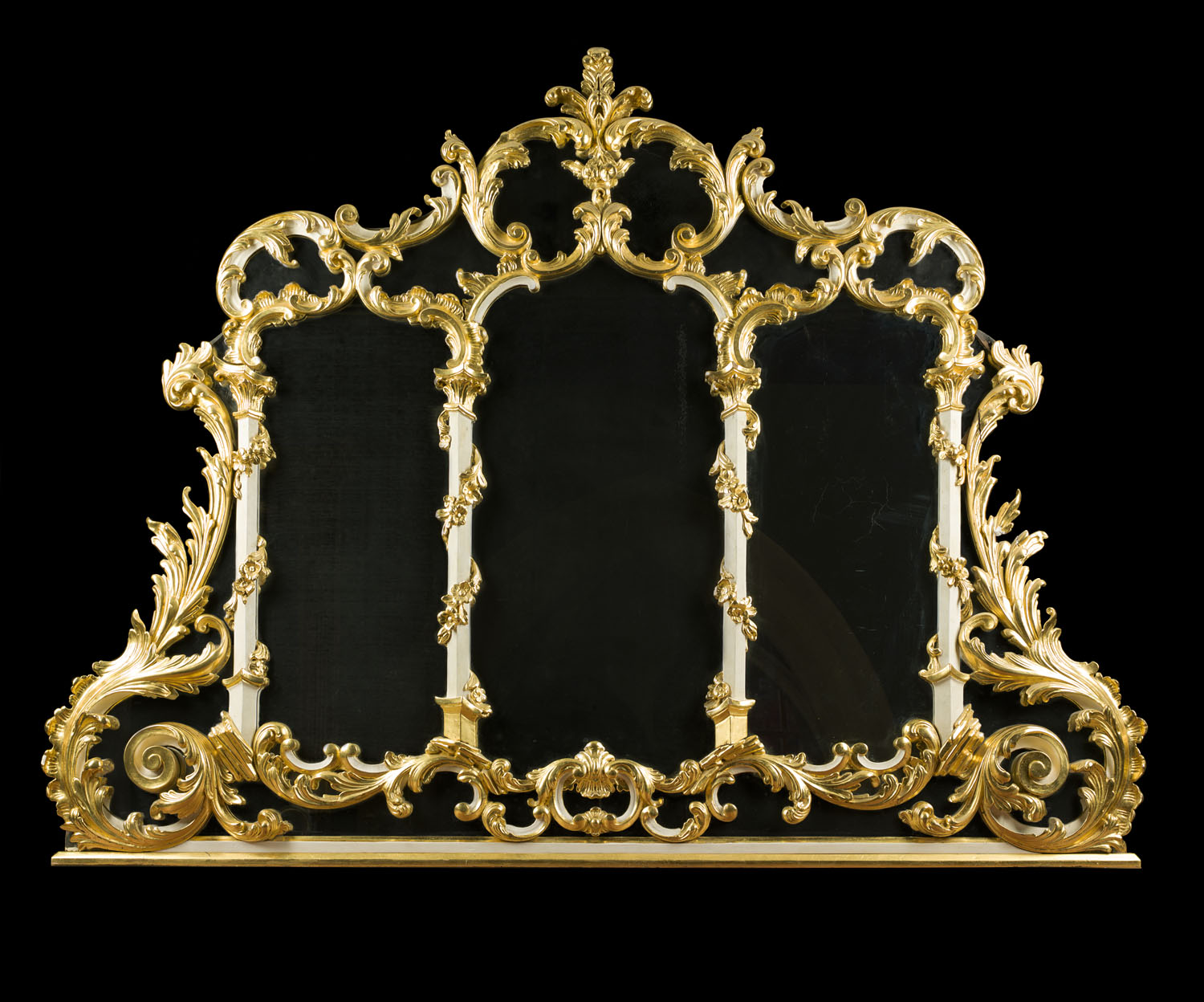 A large giltwood Rococo Revival overmantel mirror