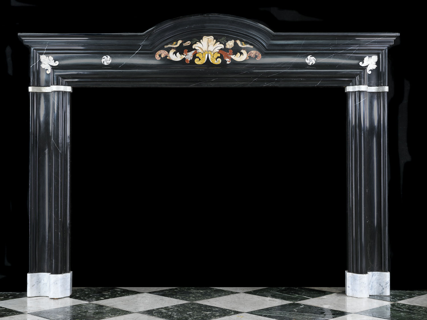 A 17th century Italian Baroque Nero Antico Marble Fireplace Surround