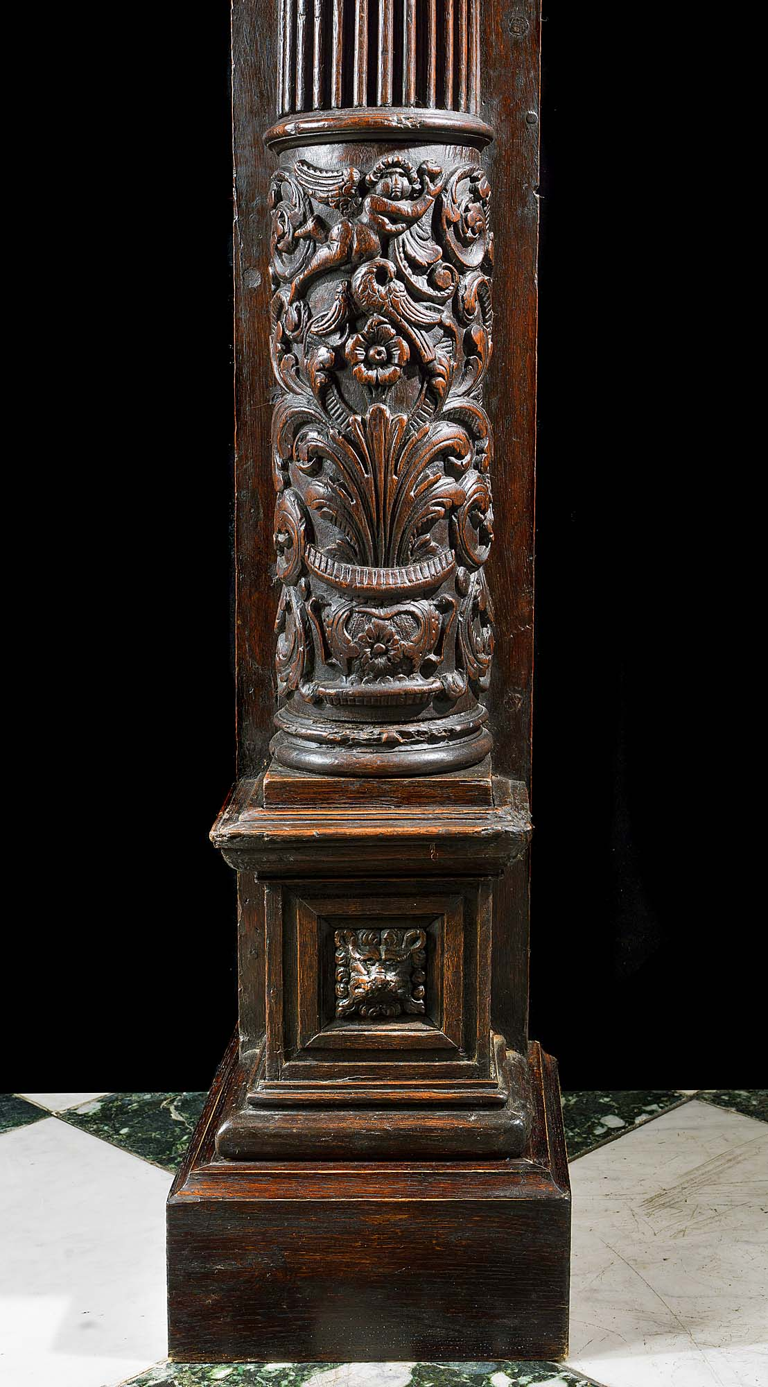A French Renaissance style carved oak fireplace surround.