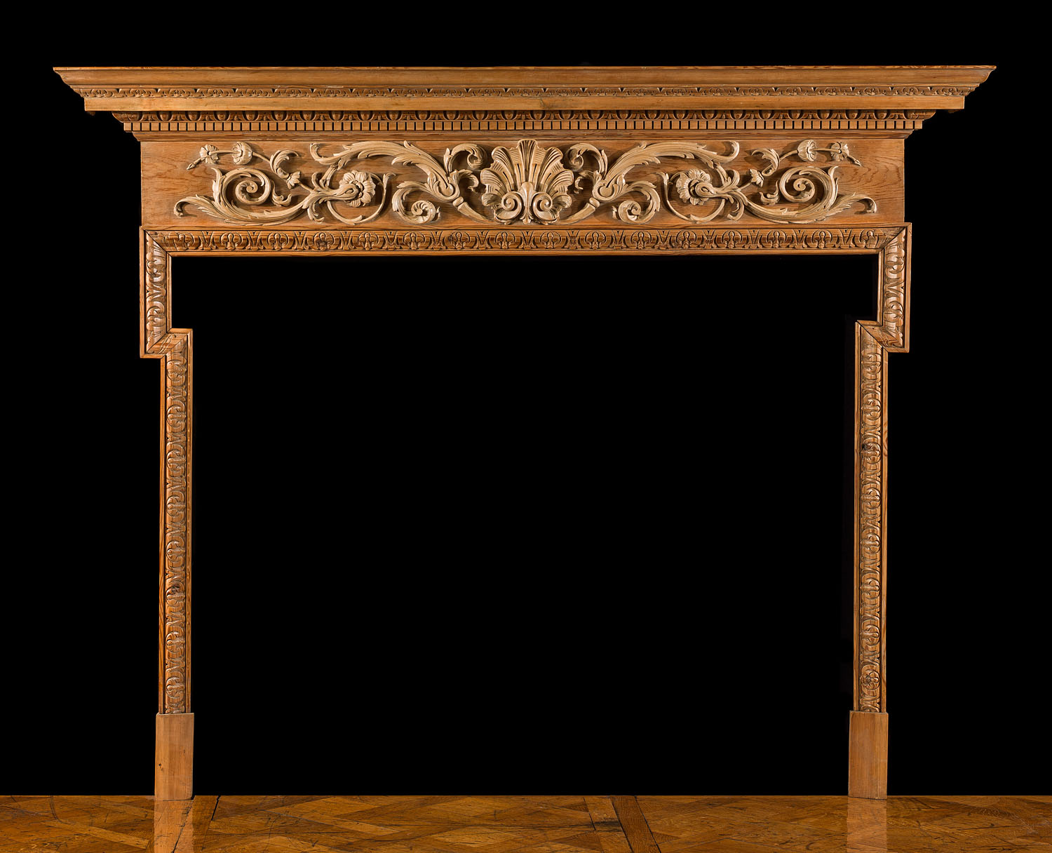 An antique Rococo style fireplace mantel
