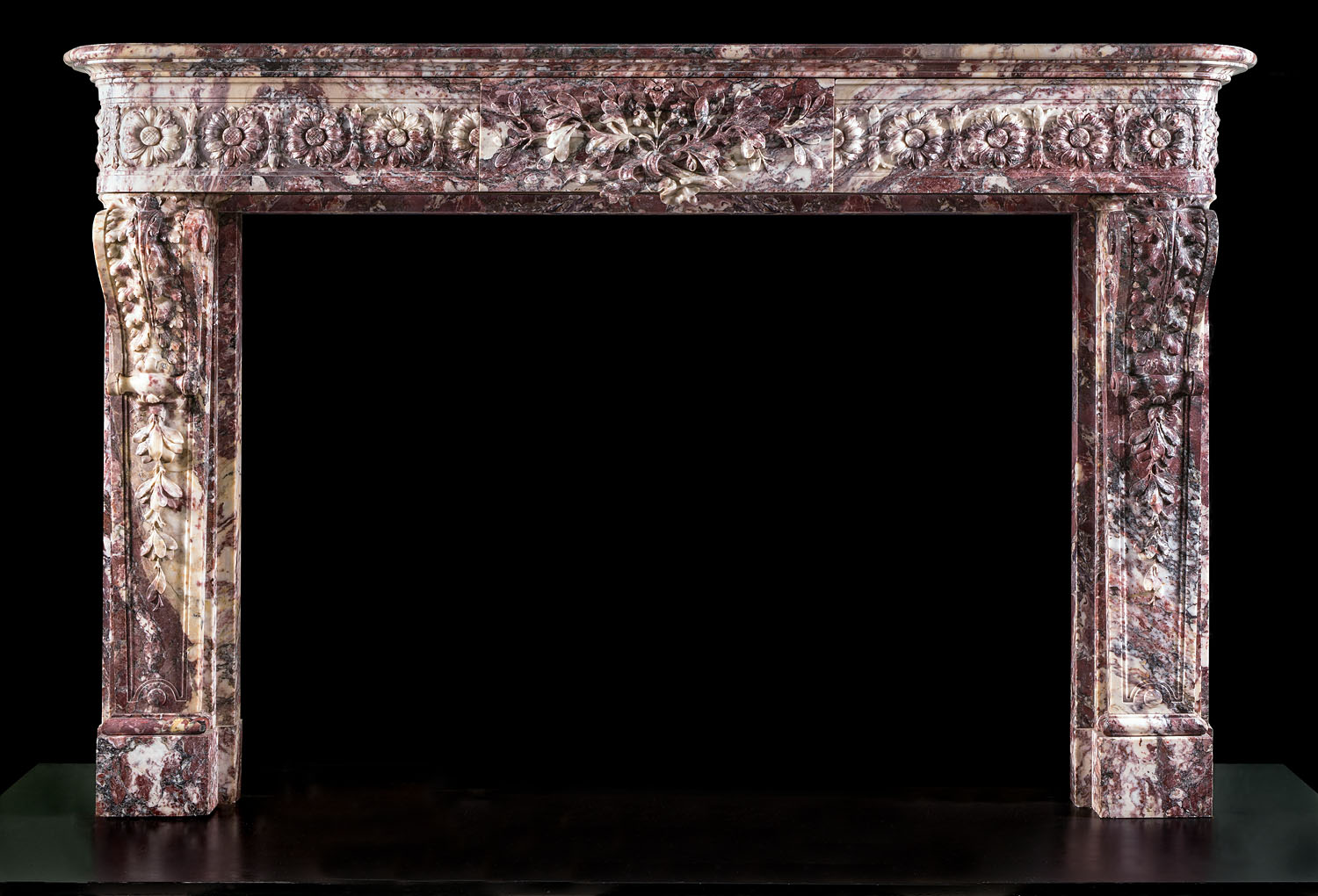 A beautiful antique Louis XVI Fleur de Pecher Cheminee Fireplace Surround
