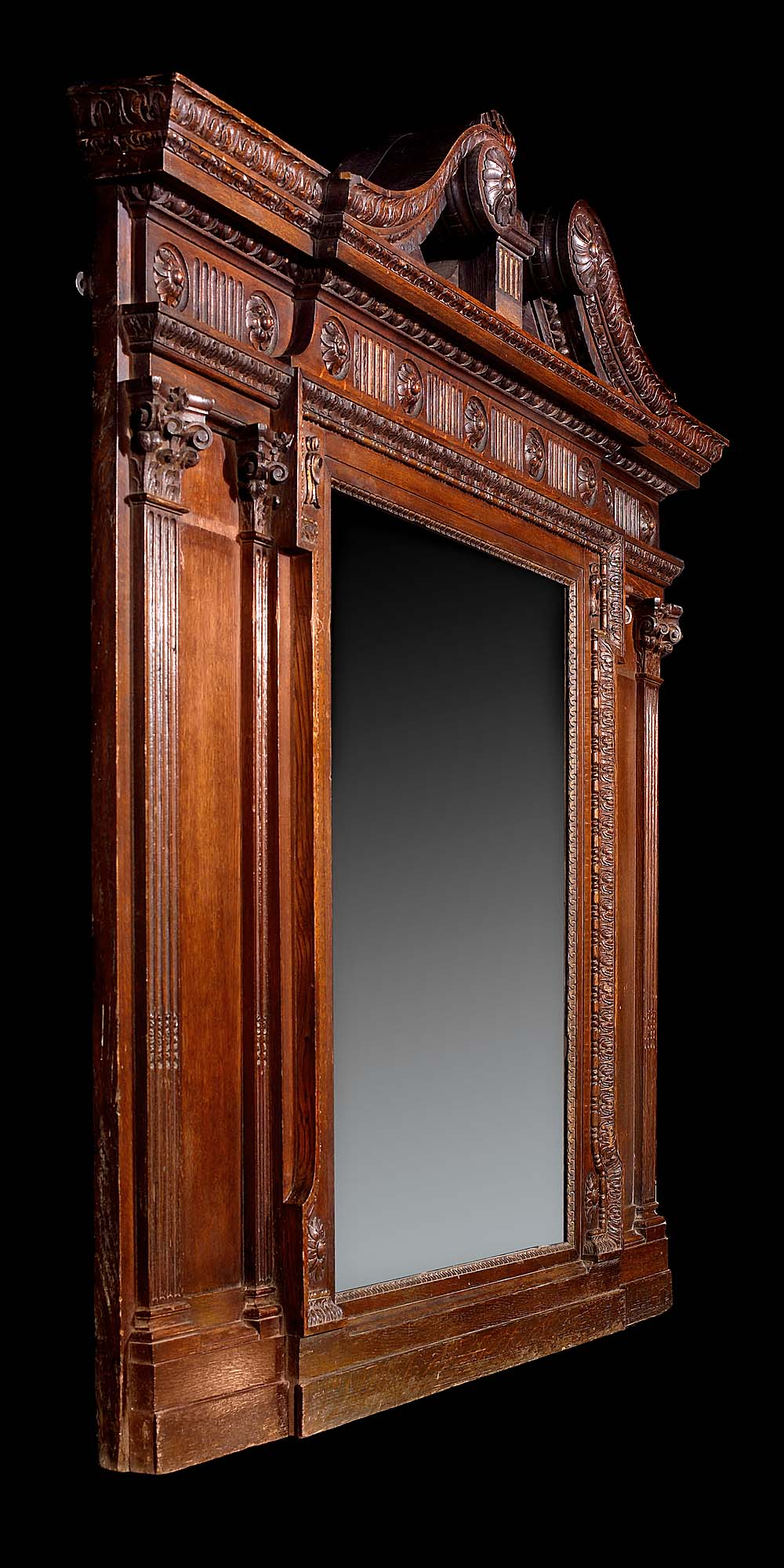 A large Palladian style Victorian oak overmantel mirror