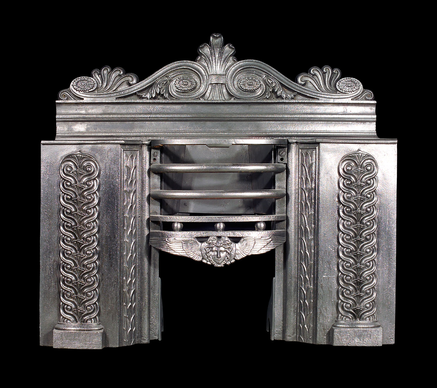 An antique Regency cast iron Hob Grate in the Greek Revival manner
