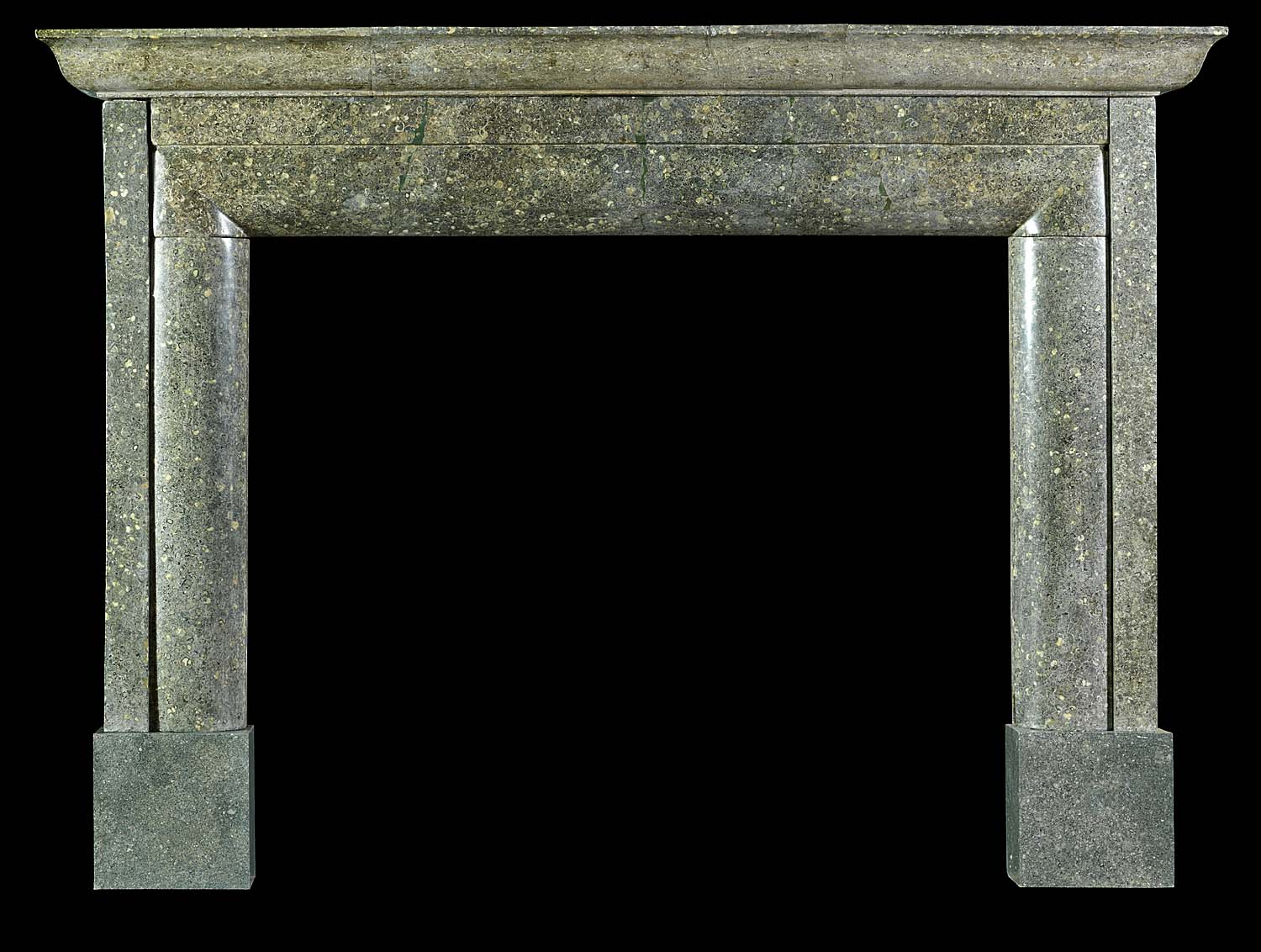 Antique Bolection fireplace in Fossil Purbeck Green Marble  A large Purbeck Green Marble chimneypiece in unadorned elegance.