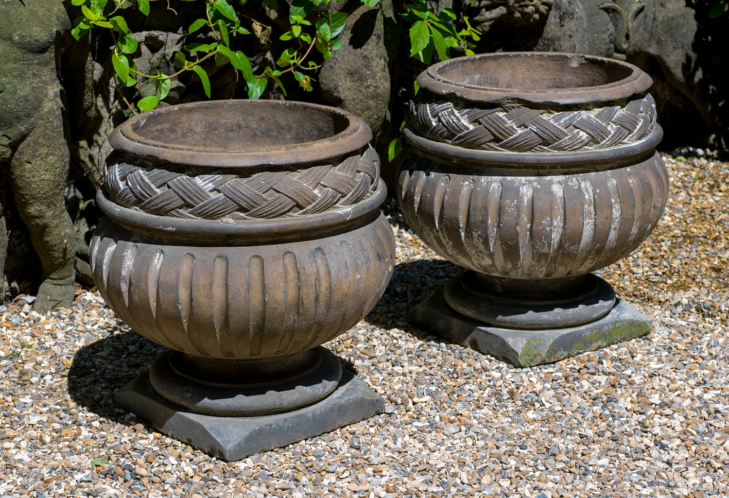 A pair of Baroque style 1930's terracotta garden urns