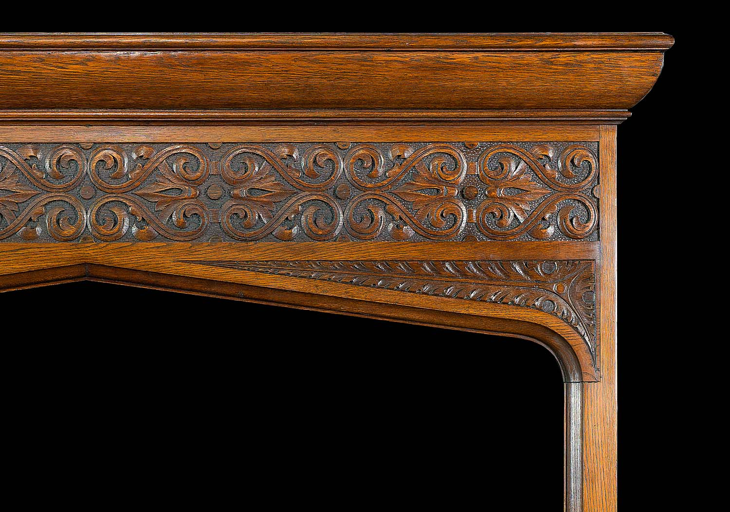 A Gothic Revival oak antique fireplace with Celtic patterned carving