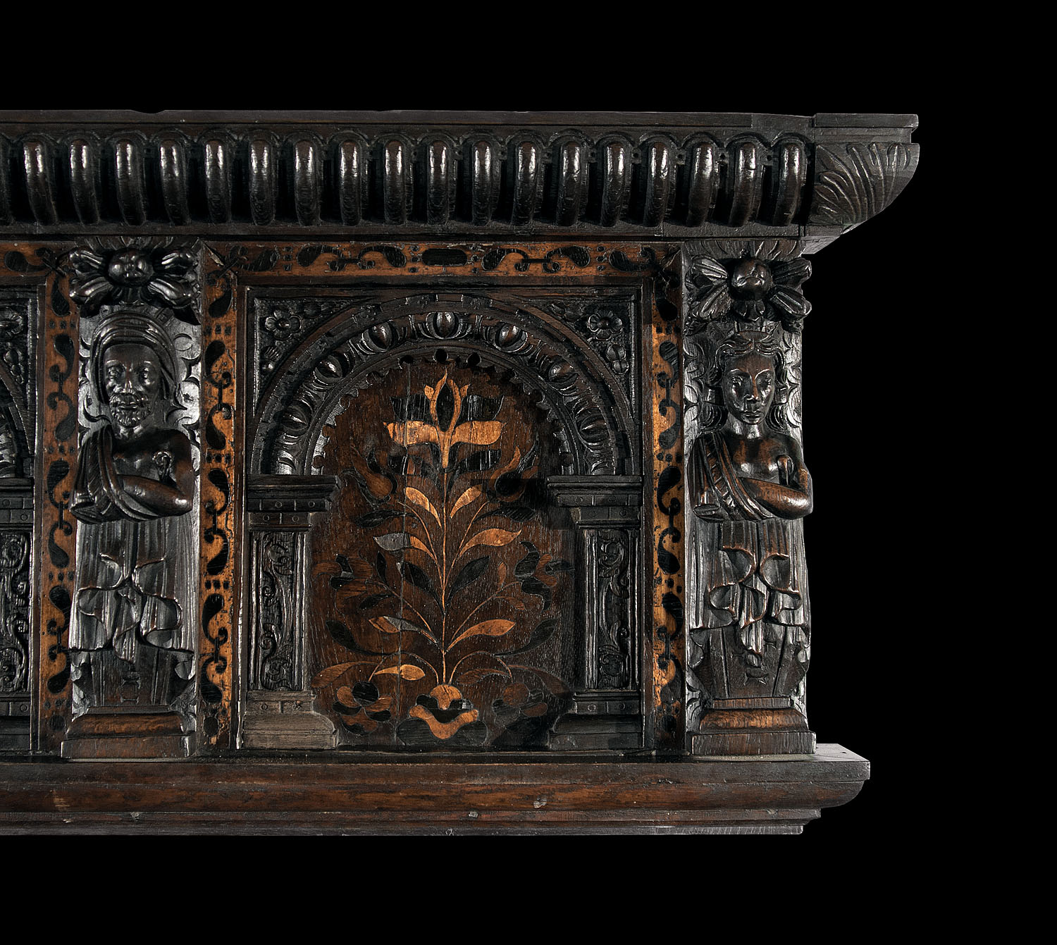 A small 17th century antique oak and inlaid wood overmantle