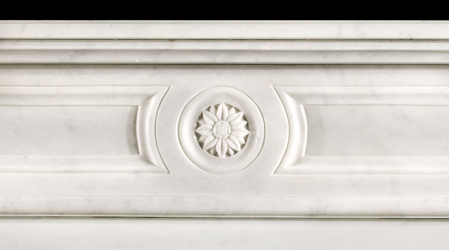 A small Louis XVI Carrara Marble Fireplace Mantel
