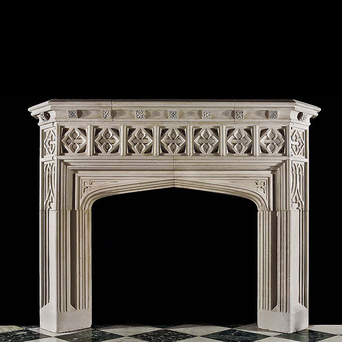 A limestone Gothic Revival fireplace mantel.