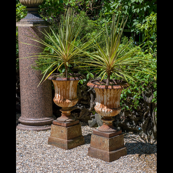 A pair of Victorian cast iron garden urns