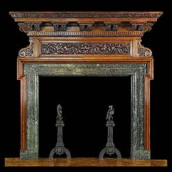 10024: A SUBSTANTIAL CARVED OAK CHIMNEYPIECE IN THE PALLADIAN MANNER. The undermoulding of the large tiered shelf is carved with repeating acanthus leaf, and supported on seven pairs of scrolled acanthus lea