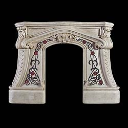 10040: An unusual small white marble Arts and Crafts fireplace surround with inlaid black red and blue lapis marble inlaid rambling roses framing a small arched opening. The serpentine shelf above a shaped a