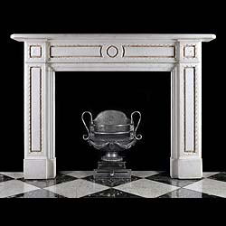 10058: One of a pair of well proportioned Regency style Statuary Marble chimneypieces the panelled frieze centred by a rosette medallion framed by inlaid Spanish Brocatelle Marble within delicately carved en