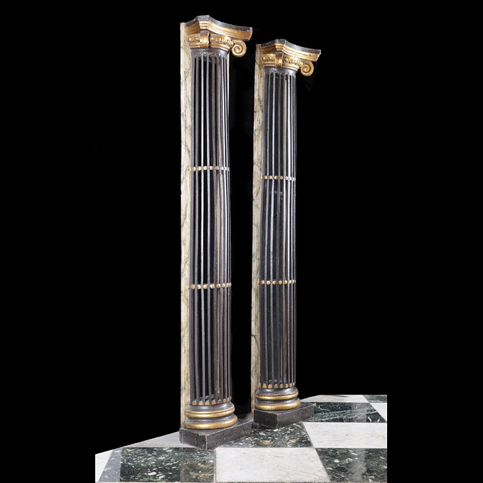 A pair of Regency style ebonised wood columns.