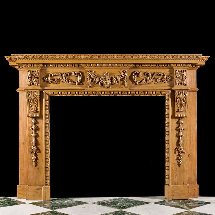 A Carved Pine Neoclassical Style Fireplace