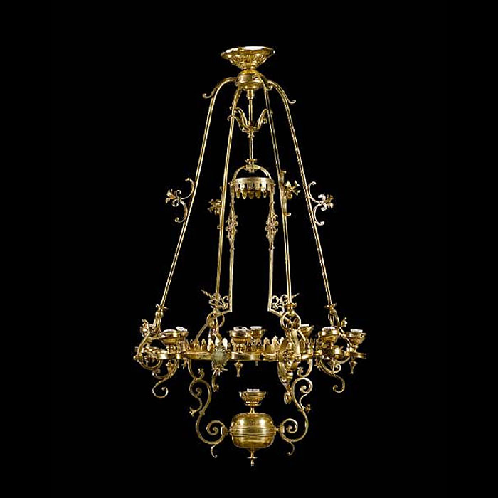 An eight light brass antique chandelier