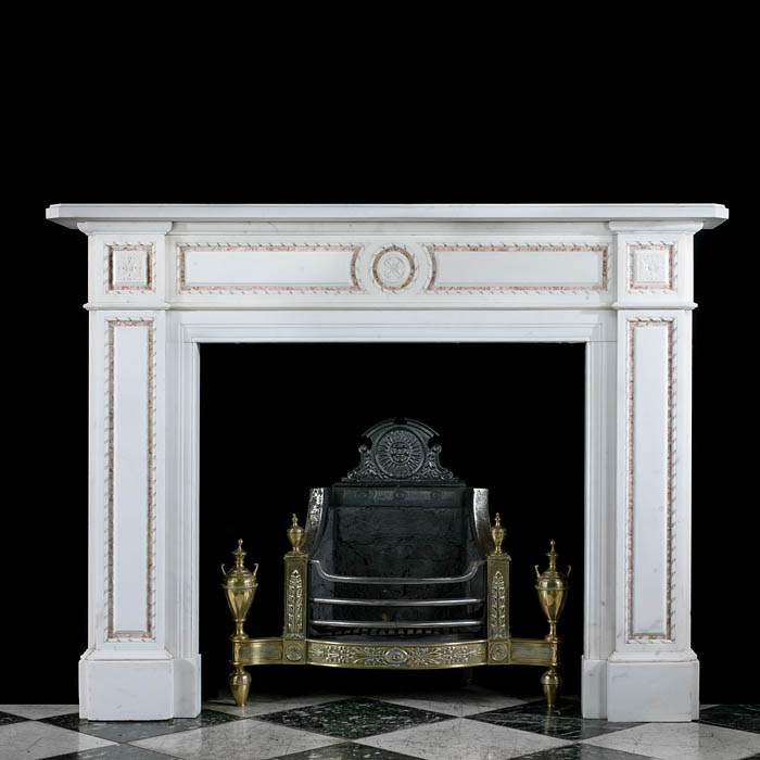 10187: One of a pair of well proportioned Regency style Statuary Marble chimneypieces the panelled frieze centred by a rosette medallion framed by inlaid SpanishBrocatelle Marble within delicately carved ent