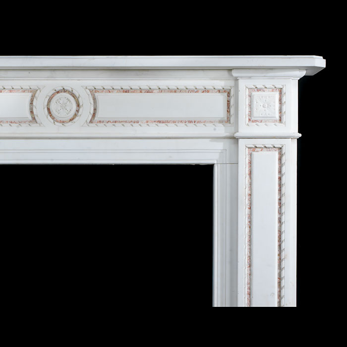 One of a pair of antique Regency style statuary and brocatelle fireplace surrounds