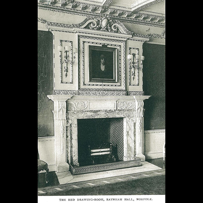 An antique fireplace surround in the manner of William Kent