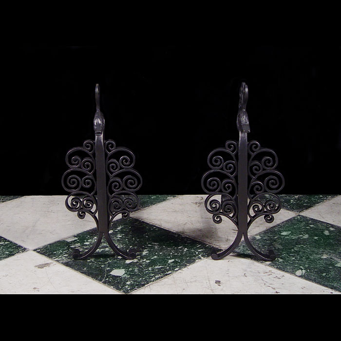 A pair of Antique wrought iron andirons attributed to Edgar Brandt