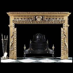 10258: A boldly carved pine chimneypiece in the early Georgian Palladian manner. The breakfront shelf with carved floral detail over egg and dart undershelf over acathus leafed frieze centred by a large fema