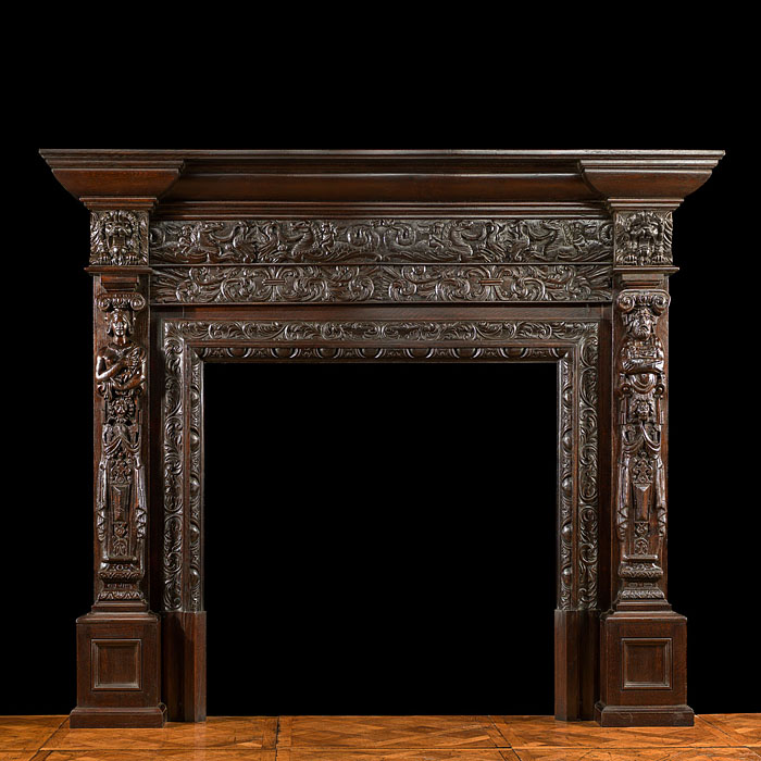 An antique Jacobean oak fireplace surround