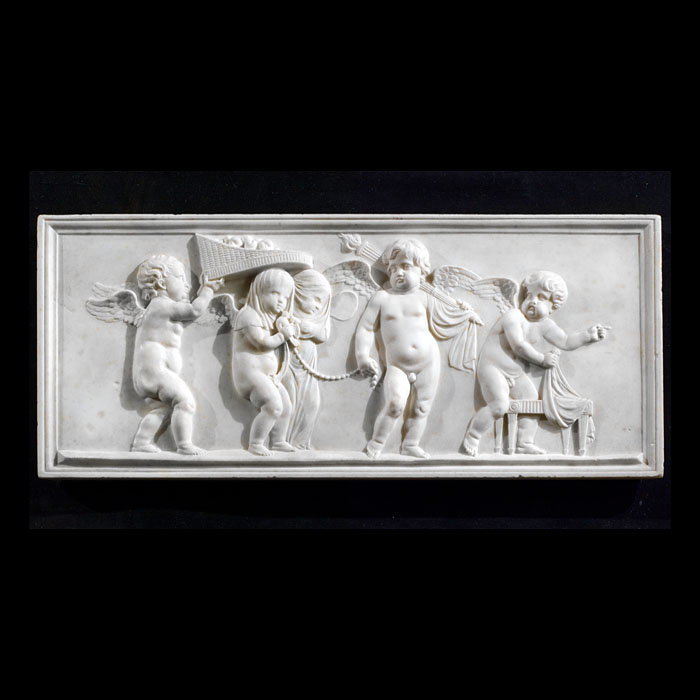 A Regency chimneypiece tablet carved in white Statuary Marble