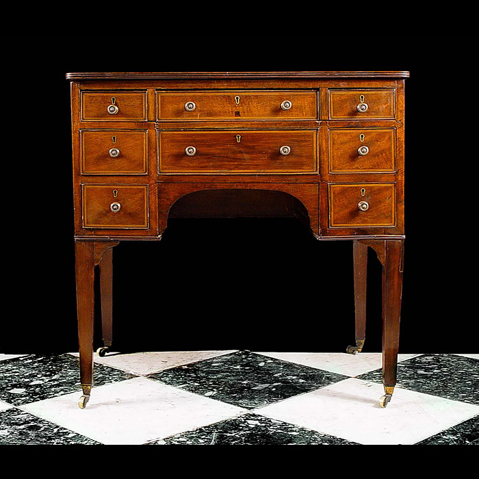 A satinwood Regency kneehole desk