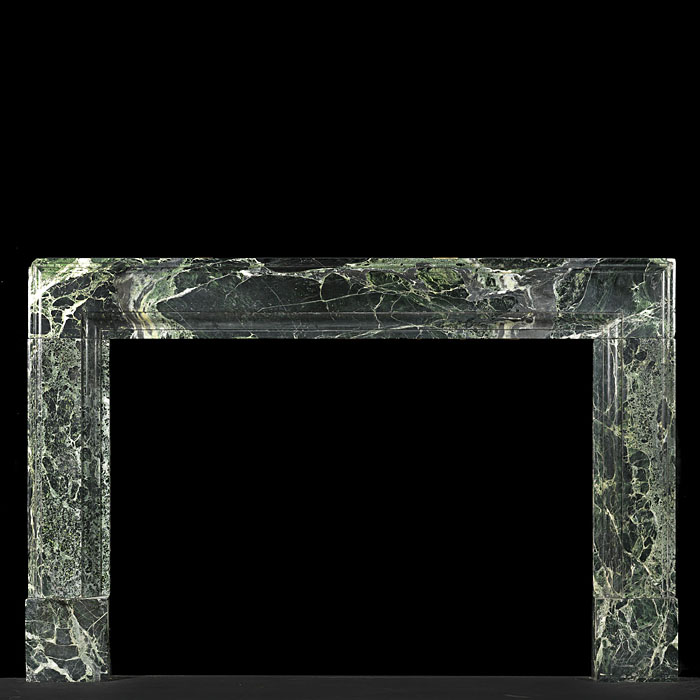 A Verdi Tinos Green Marble Art Deco Bolection fireplace