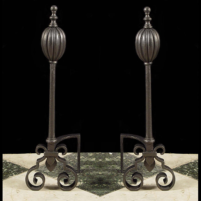 One of two pairs of cast iron Antique gadrooned andirons