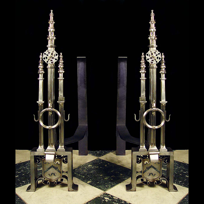 A superb pair of Reformed Gothic burnished steel andirons