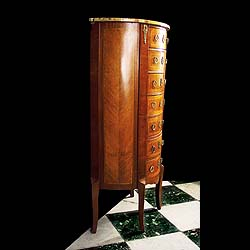 A tall Victorian Kingswood and Walnut demi lune chest