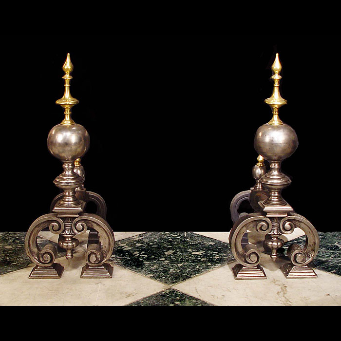 An Antique pair of casts iron Baroque style andirons