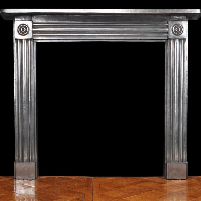 A Victorian burnished bulls eye Antique fireplace mantel