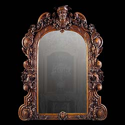 A large Baroque style carved oak antique mirror