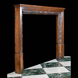 An Edwardian carved oak antique fireplace surround