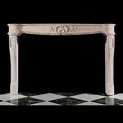An Antique French Limestone Chimneypiece