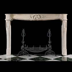 An antique Louis XVI limestone chimneypiece