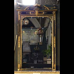 A black lacquered Renaissance Revival overmantel mirror