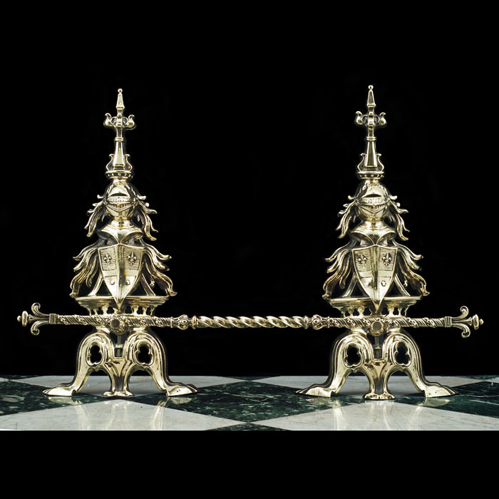 A pair of Antique brass Gothic Revival armorial andirons