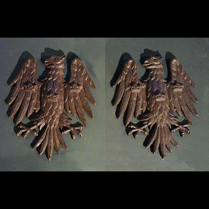 A pair of cast bronze wall eagles