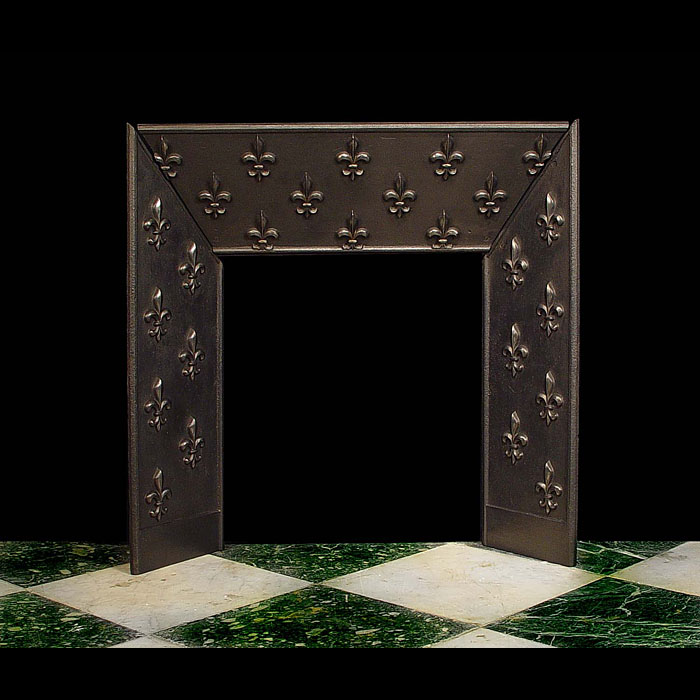 A cast iron Fleur de Lys Antique Fireplace Insert