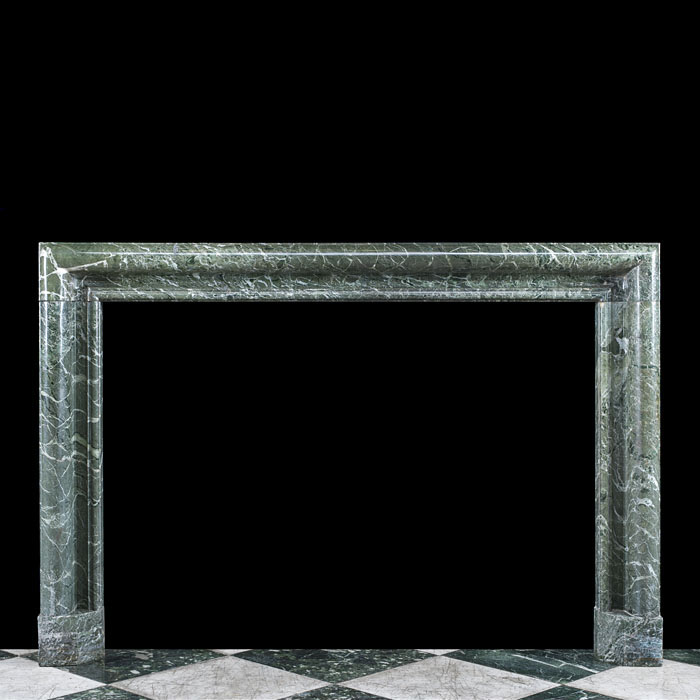 A 19th century Tinos Verde Marble Bolection Fireplace